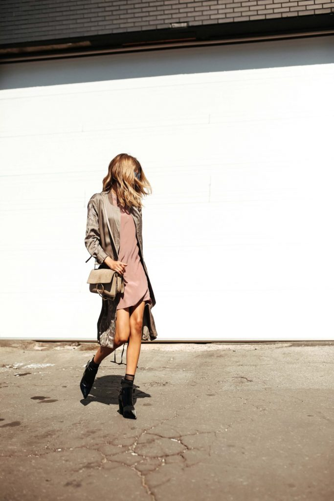Cristina Monti is rocking this beautiful fall style, consisting of a soft silk jacket, worn over a blush pink slip dress and paired with black stilettos for an authentic, feminine style.   Dress/Jacket: All Saints, Boots: Mimosa.