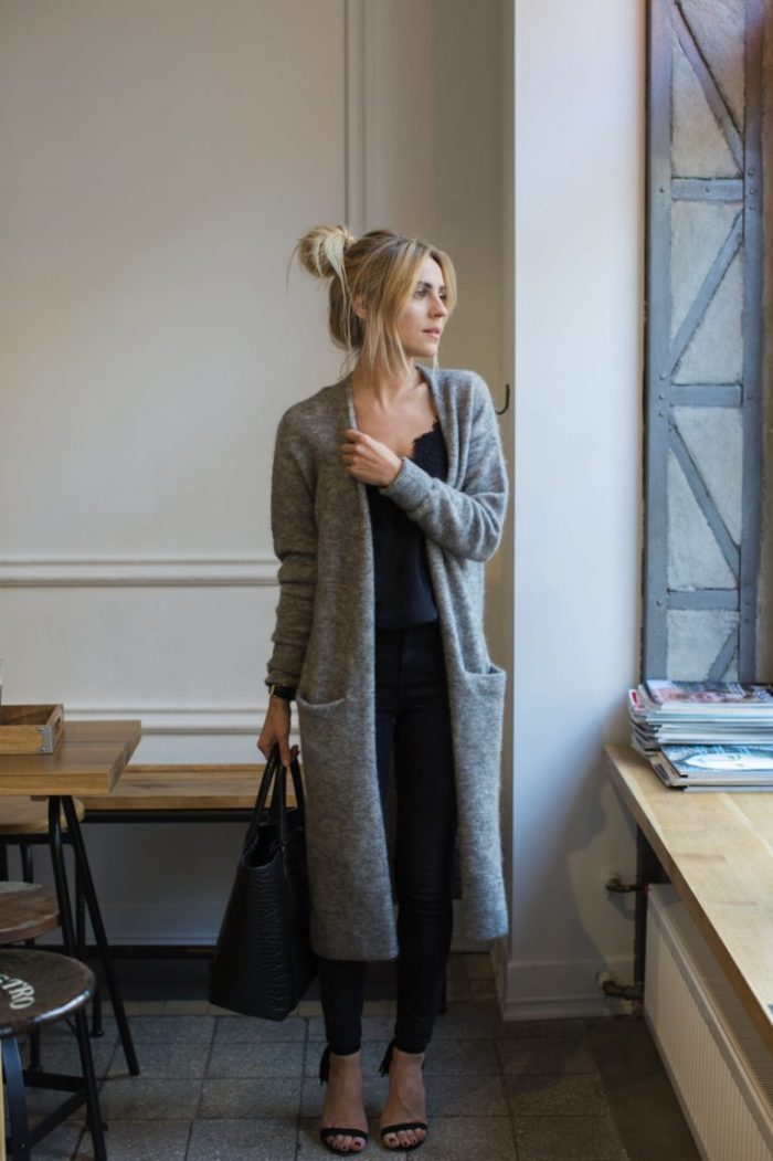 Katarzyna Tusk demonstrates the ultimate cosy chic look here, in a gorgeous knitted max cardigan, worn simply with black jeans and a matching top. Wear this look with sandals or boots for a casual yet stylish look. Sweater: & OtherStories, Jeans: Topshop, Top: Massimo Dutti, Boots: Tallinder