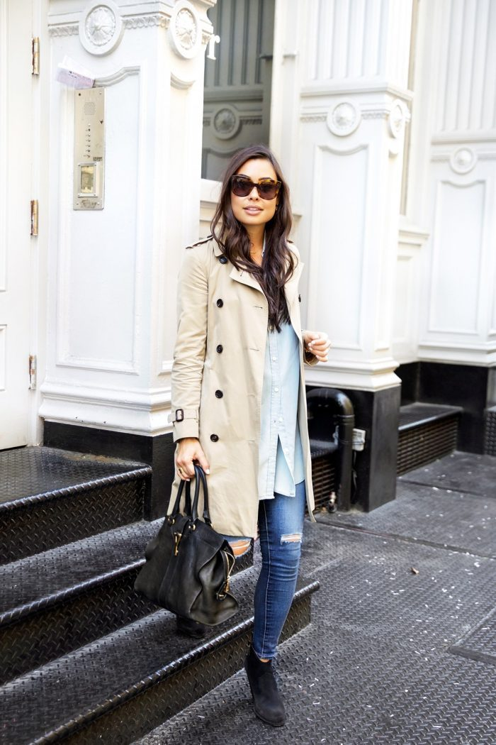 Kat Tanita is killing it in a gorgeous cream trench by Burberry, worn casually with a pair of distressed jeans and an oversized blouse. Finish this look with a pair of wide-brimmed shades and a leather bag to capture this style. Trench: Burberry, Jeans: Shopbop, Boots: Fraye.