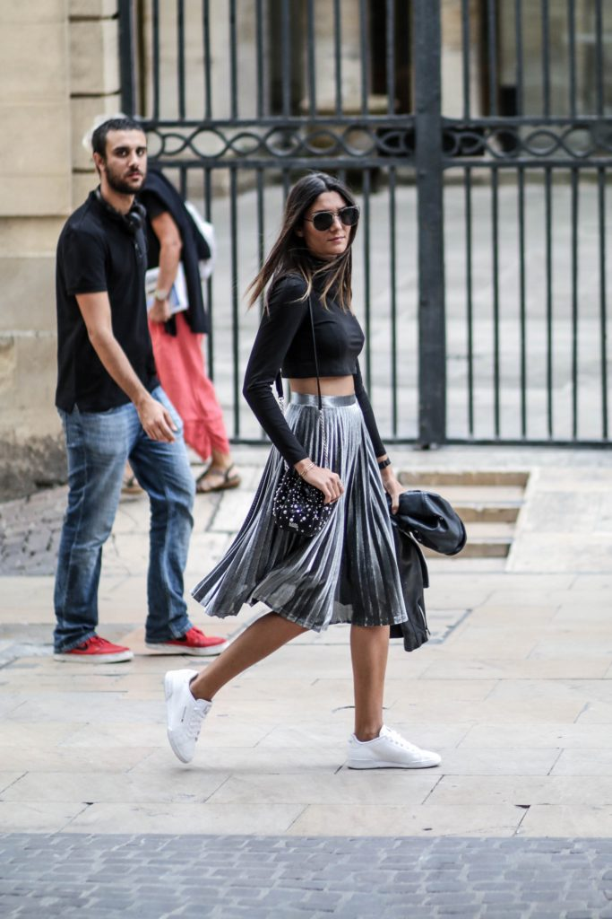 Pleated skirts are absolutely in this fall; Federica L. pairs this metallic piece with white sneakers and a crop top for a simplistic but authentic autumnal style.   Skirt: Na-kd, Trainers: Reebok.