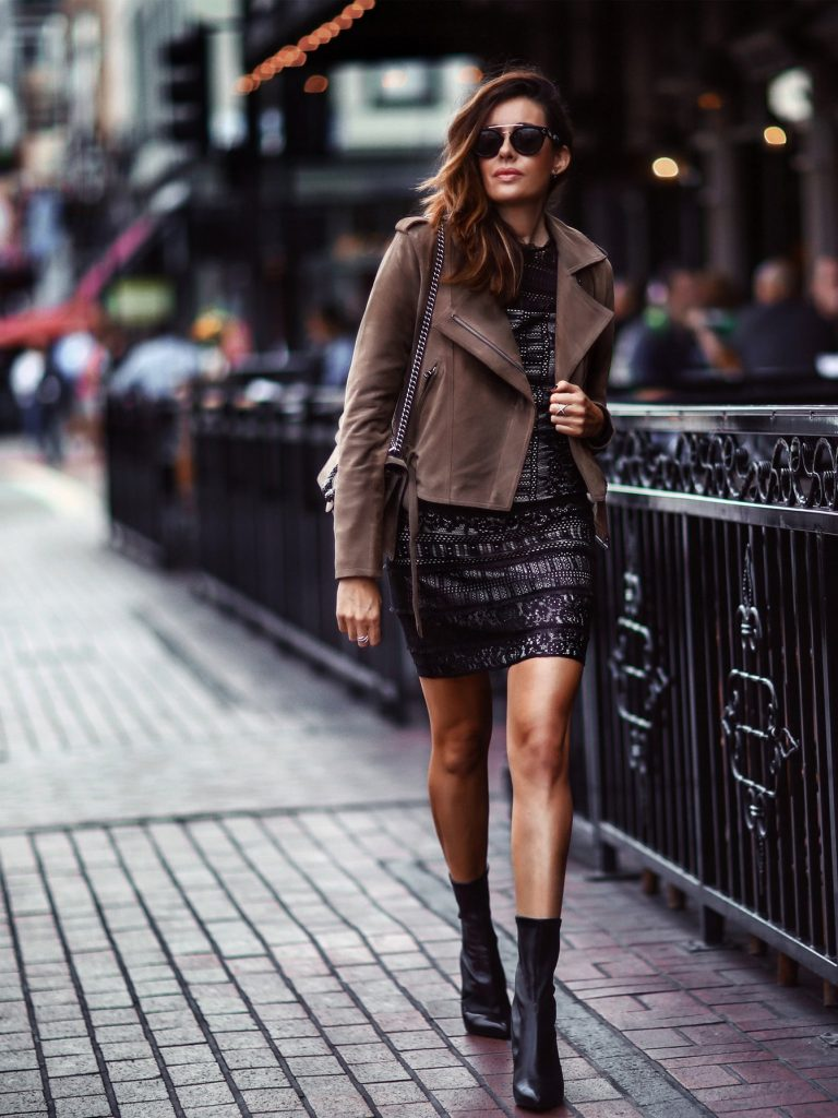 Erica Hoida is absolutely working this autumnal style consisting of a brown suede jacket, a lace dress, and a pair of sophisticated ankle boots. A look such as this is a must-try this fall. Jacket: Parker, Dress: Parker, Shoes: Stuart Weitzman, Bag: Gucci.