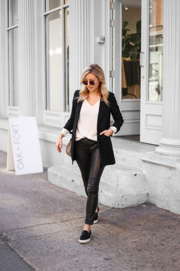 Laurie Ferraro is debuting an androgynous look consisting of a jet black blazer and a pair of striking leather leggings. Pairing this style with a plain white tee or jumper will allow for the perfect contrasting colour scheme. Leggings: ElleSD, Blazer: LXE, Knit: Halogen Cashmere, Sneakers: Axel Ariagato.