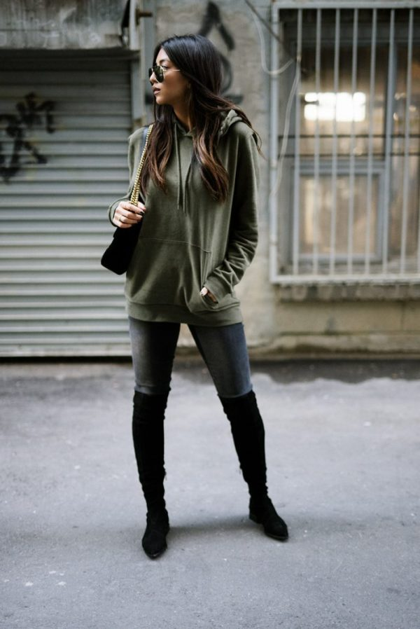 Don't be afraid to venture out in a hoodie this falll sometimes a stripped back look will trump the alternative! Kayla Seah is looking relaxed and confident in this stylish khaki hoodie, paired with over the knee boots and standard grey jeans. Hoodie: Topman, Jeans: DSTLD, Boots: Siergerson Morrison, Bag: Gucci.