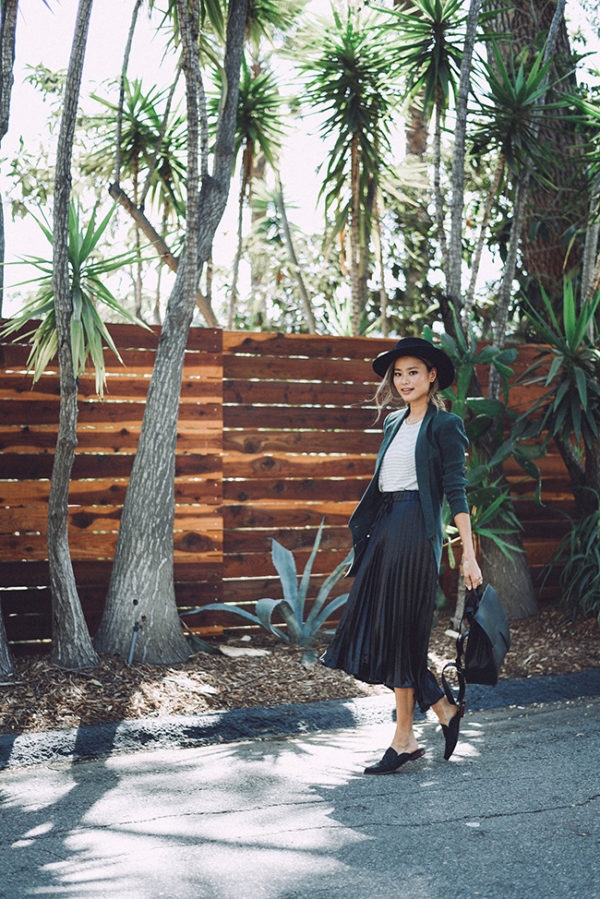 Pleated skirts are making a huge comeback this fall; pair yours with a simple tee and a blazer to capture Jamie J Chung's ultra cute style. This look features a classic autumnal colour palette, which is ideal for expressing yourself this season! Top/Skirt: Reese & Riley.