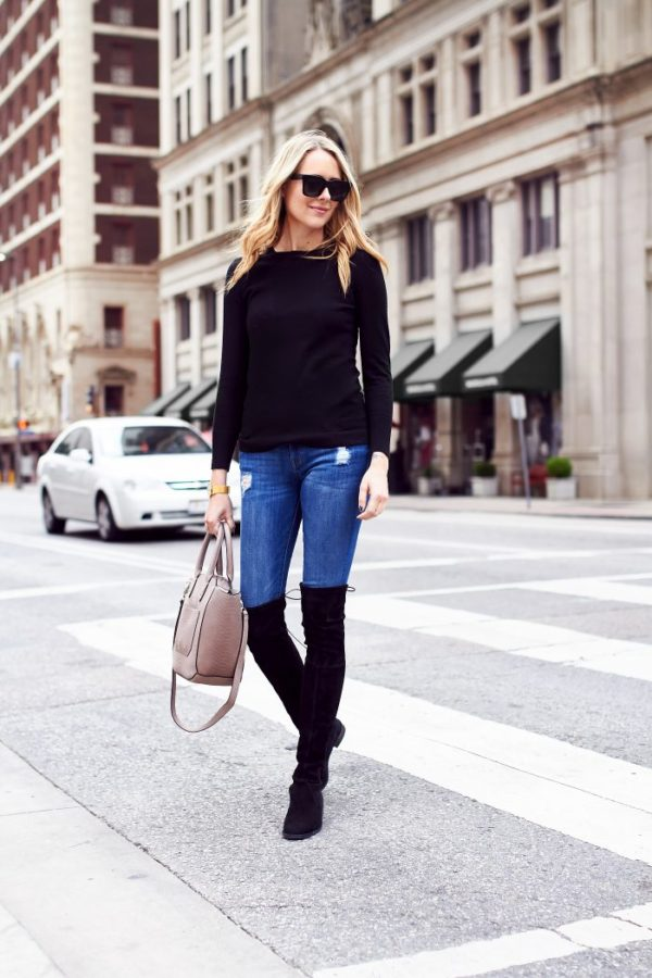 Amy Jackson is wearing a simple but effective fall outfit, consisting of jeans, a black top and a pair of over the knee boots. The contrasting colours of this look allow for a striking yet casual vibe; we love it! Jeans: DL1961, Handbag: Ivanka Trump c/o Lord & Taylor.