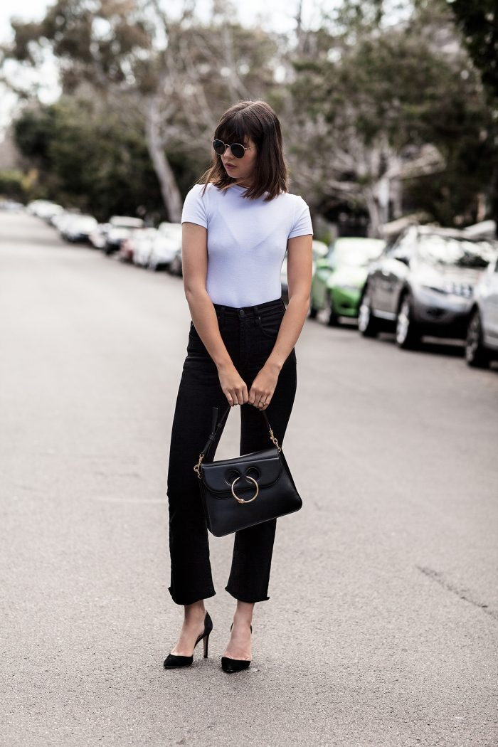 Flared trousers are an absolute win this season. Talisa Sutton has created a striking monochrome style here, in a plain white tee and black heels, worn with flared jeans for an urban edge. Tee: J Brand, Jeans: Nobody Denim, Bag: J.W. Anderson, Heels: IRO.