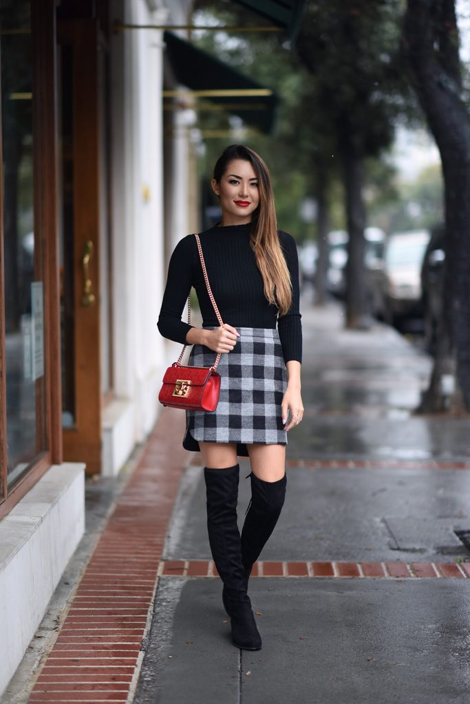 Jessica R. has mastered a cute and casual style, consisting of a black crop top and a check print skirt. Wear this look with over the knee boots to capture these casual yet sophisticated vibes. Skirt: Madewell, Top: F&F, Boots: Charles David.