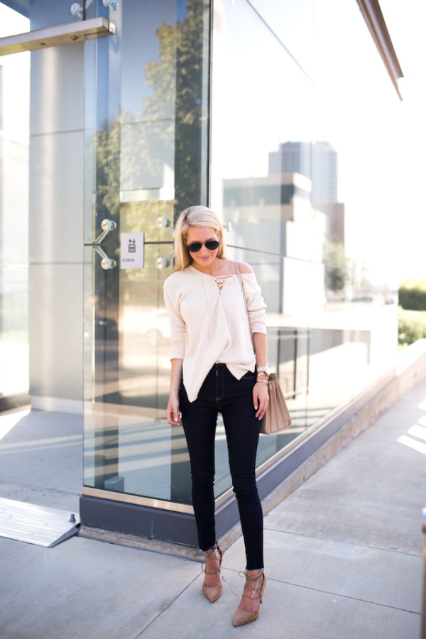 Krystal Schlegel is sleek and sophisticated in this fall outfit, consisting of a string front top and skinny denim jeans for a simple yet effective style. Wear this look with strappy heels to capture the essence of Krystal's look! Heels: Sam Edelman, Sweater: Nordstrom, Jeans: Rag and Bone, Bag: Saint Laurent.