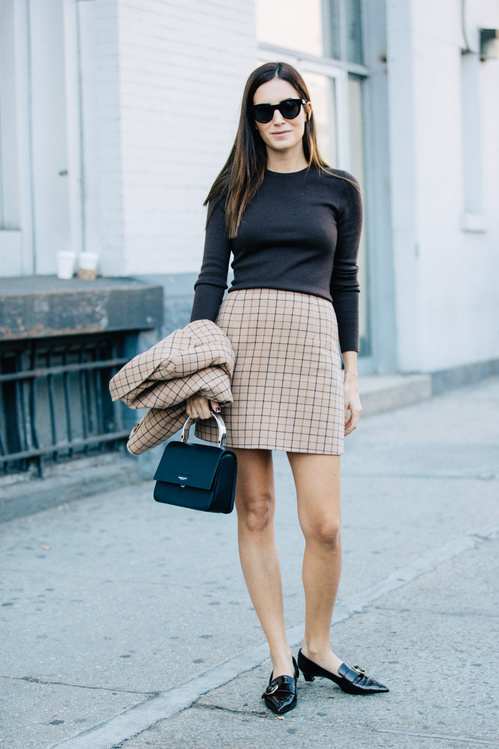 Gala Gonzalez is rocking a sleek and sophisticated fall style, in a coordinated skirt suit and work style loafers. Pair a similar look with a long sleeved top and a miniature box bag to steal Gala's awesome style.   Brands not specified.