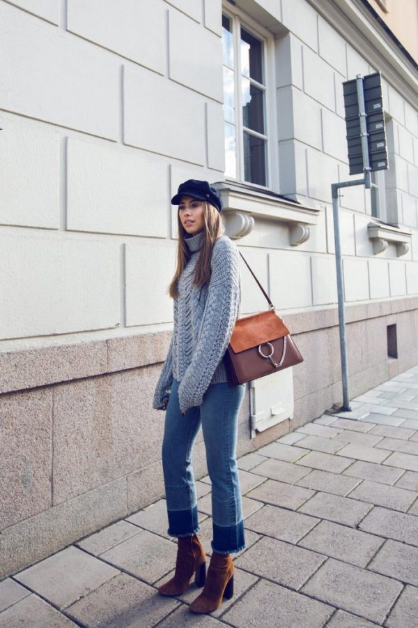 Kenza Zouiten is simply stylish in a chunky knitted sweater, cropped jeans, and heeled suede boots. Wear this look with a hat of your choice to get that fresh feel which Kenza has achieved! Jeans/Sweater: Ivy Revel, Boots: Zara.