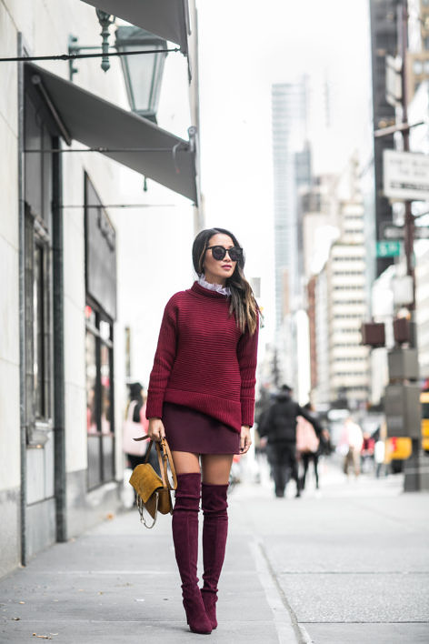 Wendy Nguyen is a vision in head to toe plum, evoking a true sense of fall fashion! Pair a knitted sweater with over the knee boots to get that sexy, yet cosy overall style.   Top: Vince Camuto, Skirt: Band of Gypsies, Shoes: Stuart Weitzman, Bag: Chloe.