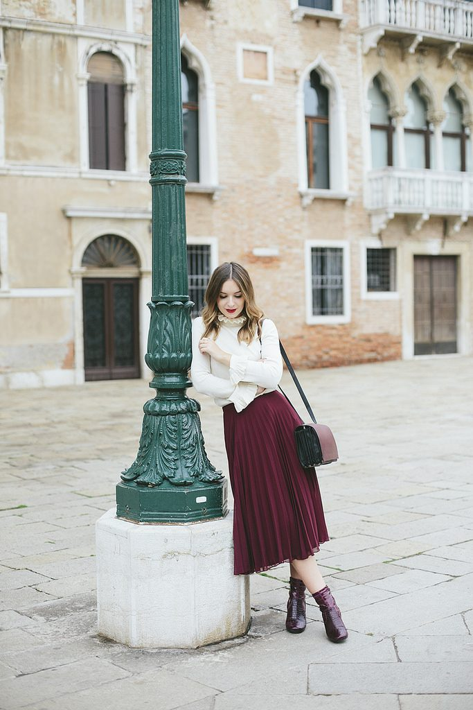 Olivia Purvis has totally captured her femininity in this gorgeous pleated skirt, in a perfectly seasonal shade of plum. Wearing this piece with a collared blouse, Olivia has created an original and authentic fall style!   Top: & Other Stories, Skirt: ASOS, Bag: & Other Stories, Boots: River Island.