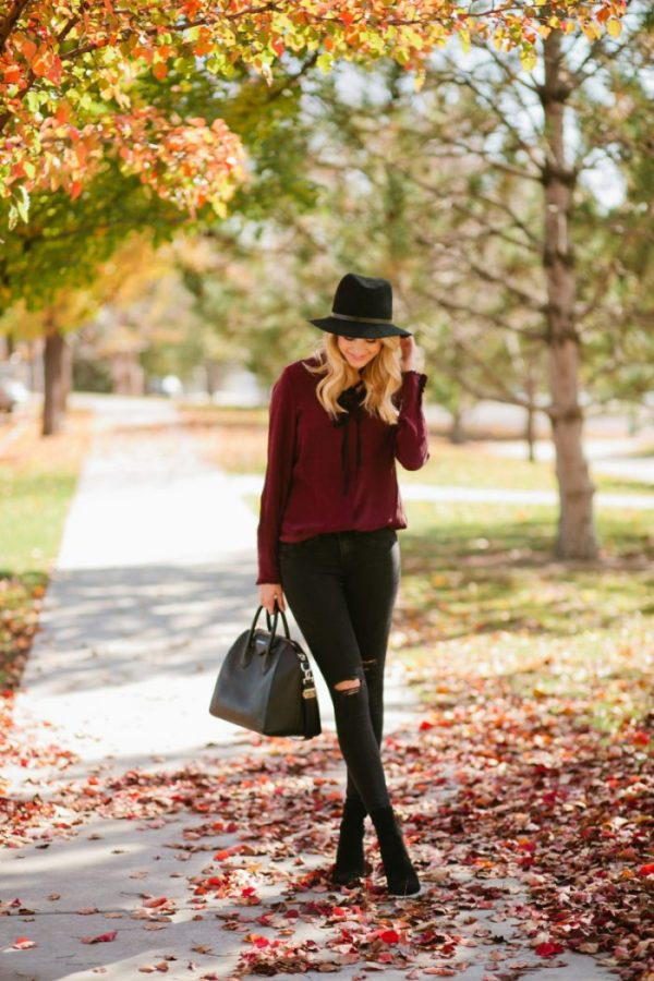 Emily Jackson is wearing a gorgeous shade of plum on this bow top, creating a truly seasonal aesthetic which is absolutely perfect for a walk in the park. Wear this look with black or denim jeans to achieve this stripped back style. Top: Frame, Jeans: Rag & Bone, Boots: Staurt Weitzman, Bag: Givenchy.