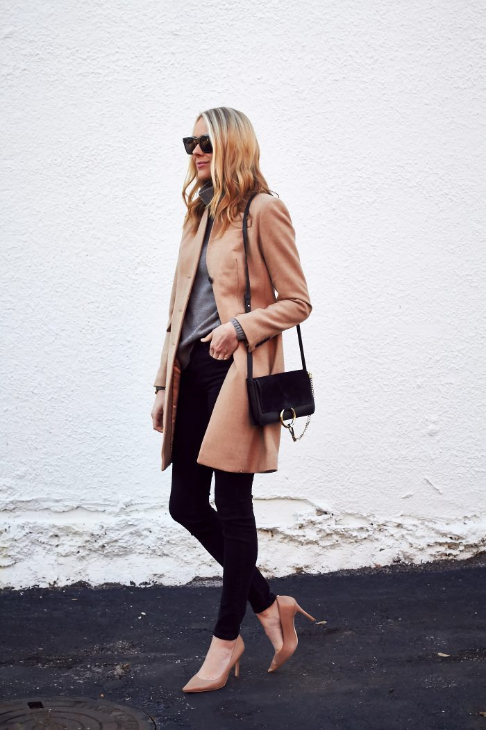 Amy Jackson spruces up a cute fall outfit with a pair of striking nude heels, which add glamour and femininity to this cosy look. Give this look a try by pairing a turtleneck sweater with a cream or camel coat and black jeans. Coat/Sweater: J.Crew, Jeans: Zara, Heels: Nordstrom, Bag: Chloe.
