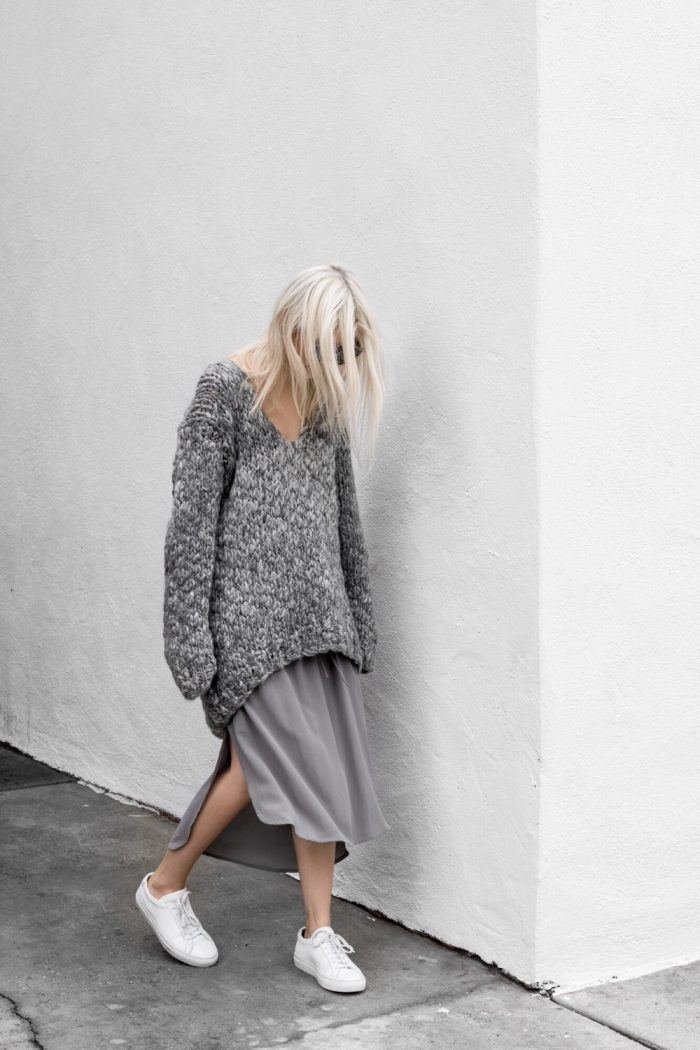 Oversized sweaters are a must this winter! Wear a knit sweater with a maxi or midi skirt and sneakers for a cosy, comfortable style. Via Figtny. Skirt: Third Form, Knit: Elliatt, Sneakers: Common Project.