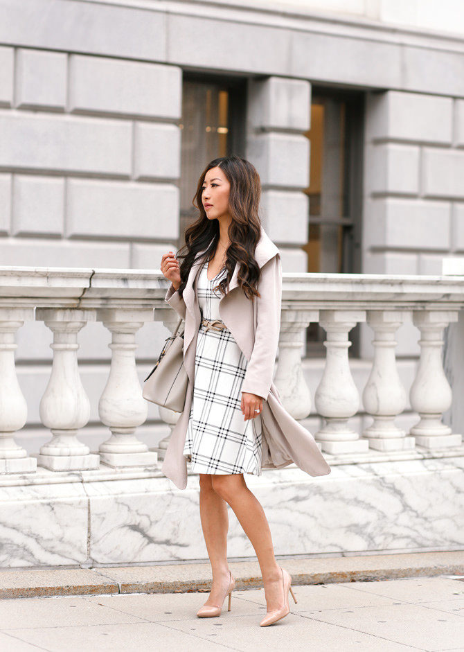 Jean Wang totally owns her femininity in this stunning patterned mini dress, worn with a cream trench for a neutral, understated look. Wear this style with nude heels to capture the essence of Jean's style. Trench: Club Monaco, Dress: Maison Jules, Heels: Manolo.