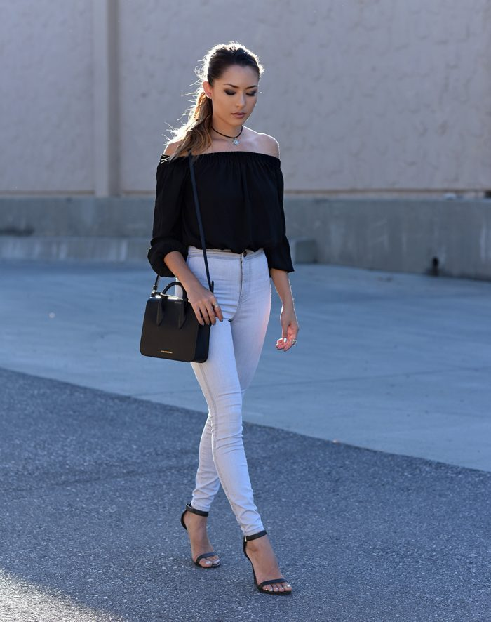 f9a8842cfbe Jessica R rocks this outfit with its straight legged high waisted jeans  with feminine off the