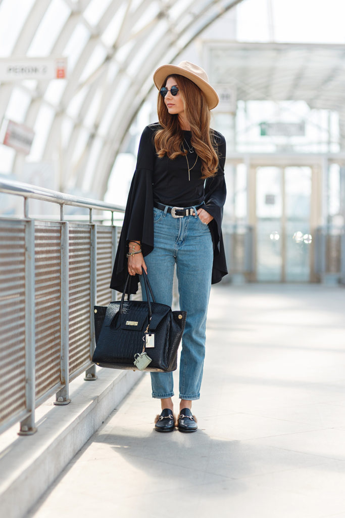 Larisa Costea brings Boho back with this look. Her bell-sleeved top is tucked into her high waisted jeans, accessorised with a muled loafer, oversized bag and caramel hat. Her retro-styled belt accentuates her waist and length of the leg.  Bell sleeve dress/top, mom's jeans and hat all by Shein, Slippers: Jessica Buurman, 15 black Harper bag: Concept, Mini bag key chain: Kurt Geiger, Watch: Kapten & Son