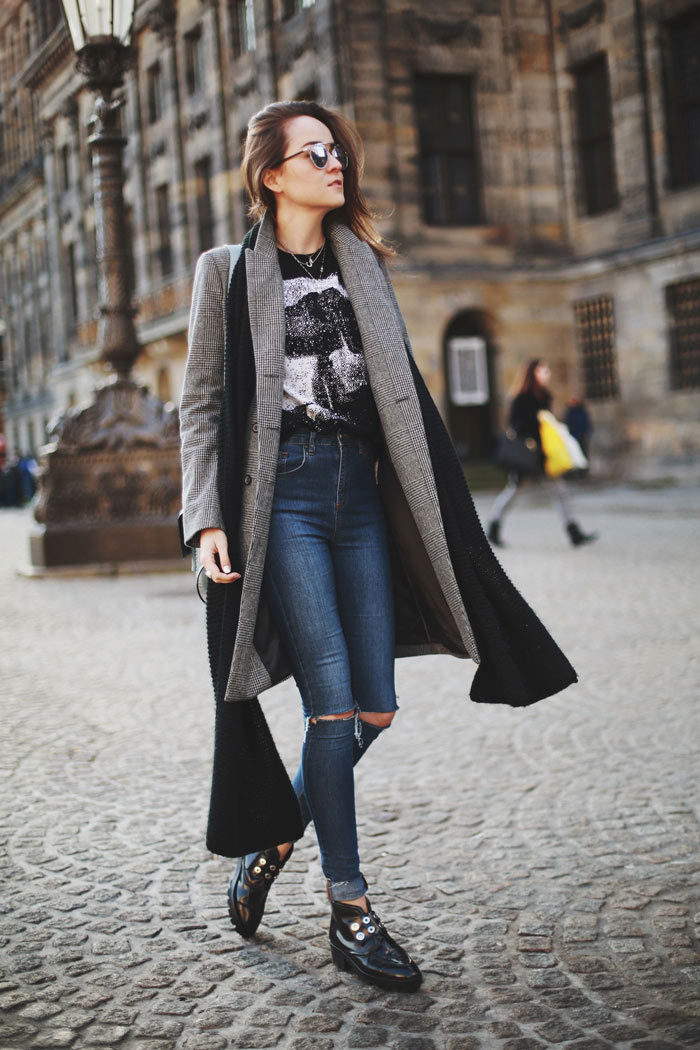 Andy Torres plays with layering with her long coat and scarf over a T-shirt tucked loosely into her high waisted jeans. The edgy ankle boots create an individual look to express her personality. Form hugging jeans show-off her slender silhouette and the ripped knees help to create this causal outfit. Snoopy Jumper: Coach x Peanuts (co), Coat: Zara (old), Shoes: Sandro, Bag: Coach, Jeans: Asos, Sunglasses: Dior