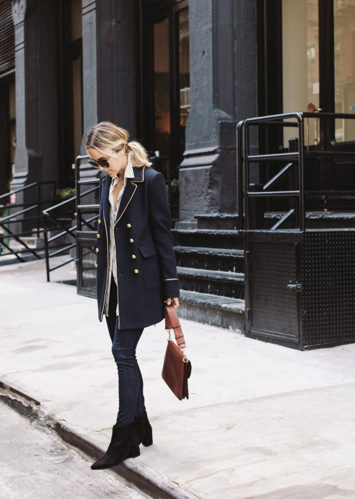 Jacey Duprie is rocking this military style jacket, pairing it with jeans and a button down shirt for a boyish, angular style which we love. Pair a similar jacket with Chelsea boots to capture the sophistication of Jacey's style.   Boots: Stuart Weitzman Zepher, Top: Rag & Bone, Jacket: Pinko, Bag: J.W. Anderson.