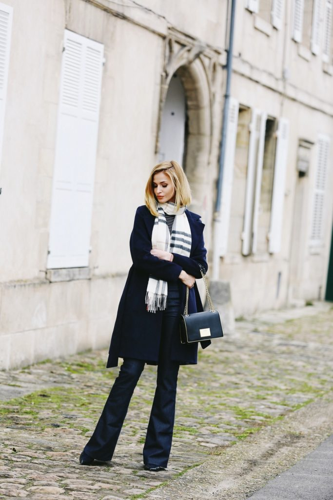 Paula Jagodzińska wears a classic military style coat with flared denim jeans, creating a sophisticated, elegant style which we love. Pair a look such as this with a scarf and minimal accessories to capture this vibe!  Coat: Lea Fashion, Trousers: Sylwia Maidan, Bag: Love Moschino, Blouse: F&F, Scarf: Burberry, Shoes: SarEnza.