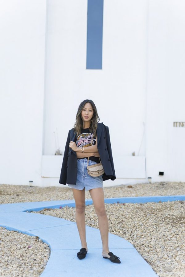 Add an androgynous edge to your mini skirt look by pairing it with an oversized blazer to create a sharp and striking silhouette for yourself. Aimee Song is rocking this twist on a classic look; we love it! Skirt: Vetements, Tee: Loewe, Bag: Chloe, Blazer: Own.