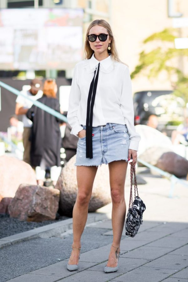 Classic and cool, Pernille Teisbaek let's us know that denim mini skirts are back with a vengeance. She pairs a vintage mini with a feminine white blouse and heels to show just how effortless this style can be. Mini skirt: Levis (vintage),Top: Chloe, Shoes: Dries Van Noten, Purse: Chanel, Earrings: Orit Elhanati, Sunglasses: Ray-Ban