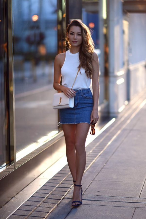 7b561fc87 A denim mini skirt will look effortlessly stylish when paired with a simple  white vest or