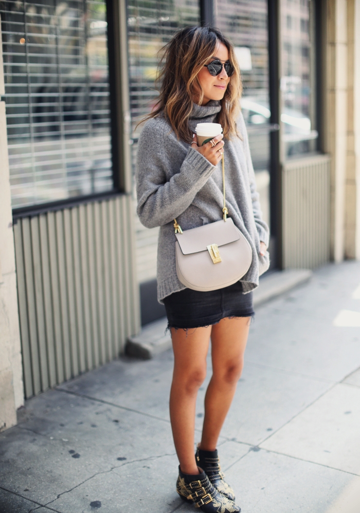 Julie Sarinana displays a cozy, modern outfit that is fashionable and simplistic. Mini skirts are quickly becoming a cool alternative to skinny jeans to show off your legs in a stylish but casual way.  Mini skirt: Current/Elliott, Top: Aritzia, Purse: Chloe, Shoes: Chloe, Sunglasses: Illesteva
