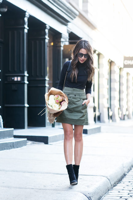 Wendy Nguyen is stunning us in this cute khaki canvas skirt. worn simply with Chelsea boots and a skin-tight turtle neck. We love the stripped back authenticity of this style! Top: Vince, Skirt: Marissa Webb, Boots: Gianvito Rossi.