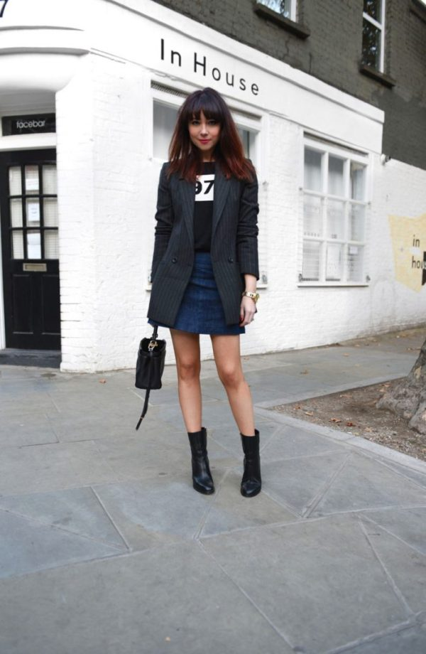 We adore this dark denim mini. Take a tip from Lorna Luxe and top your mini skirt outfits with a fitted blazer that just touches your skirt's hemline and black motorcycle boots for a work-ready style. Mini skirt: Miss Sixty, Top: Bella Freud, Jacket: Gestuz, Shoes: Dear Frances, Purse: Fendi