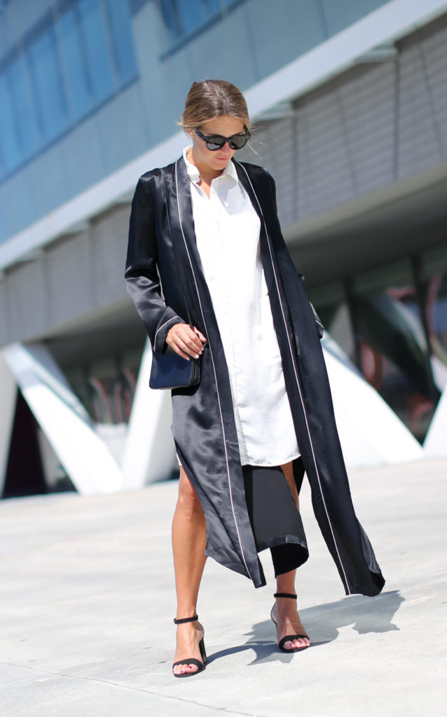 Izortze Setien rocks an elegant smart casual style consisting of a silk Zara kimono and a white shirt dress, paired with black stilettos and a red toe for a splash of colour. Wear this look with shades to bring the entire style together.   Shirt/Sandals: Zara, Dress: Gestuz, Bag: Celine.