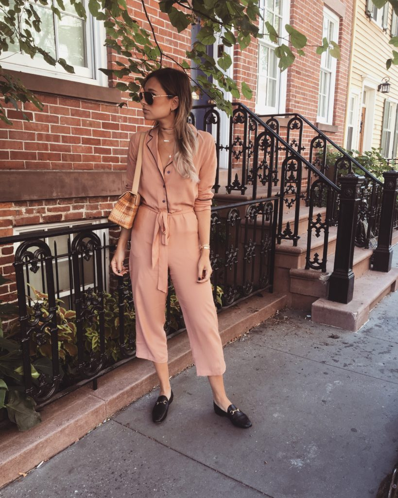 Danielle Bernstein is absolutely rocking this pyjama style, consisting of a matching peach coloured two piece with waist tie detailing in a button down style. Wear an outfit like this with loafers to get that classic feel on a modern look!  Jumpsuit: Asos, Loafers: Gucci.