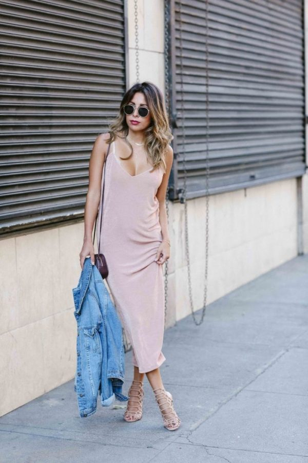 Ashley Torres is wearing a gorgeous pink slip dress in a classic pyjama style, paired with a denim jacket and matching blush pink heels for a cool, sophisticated look. Dress: Zara, Jacket: Just Fab, Bag: YSL, Heels: Steve Madden.