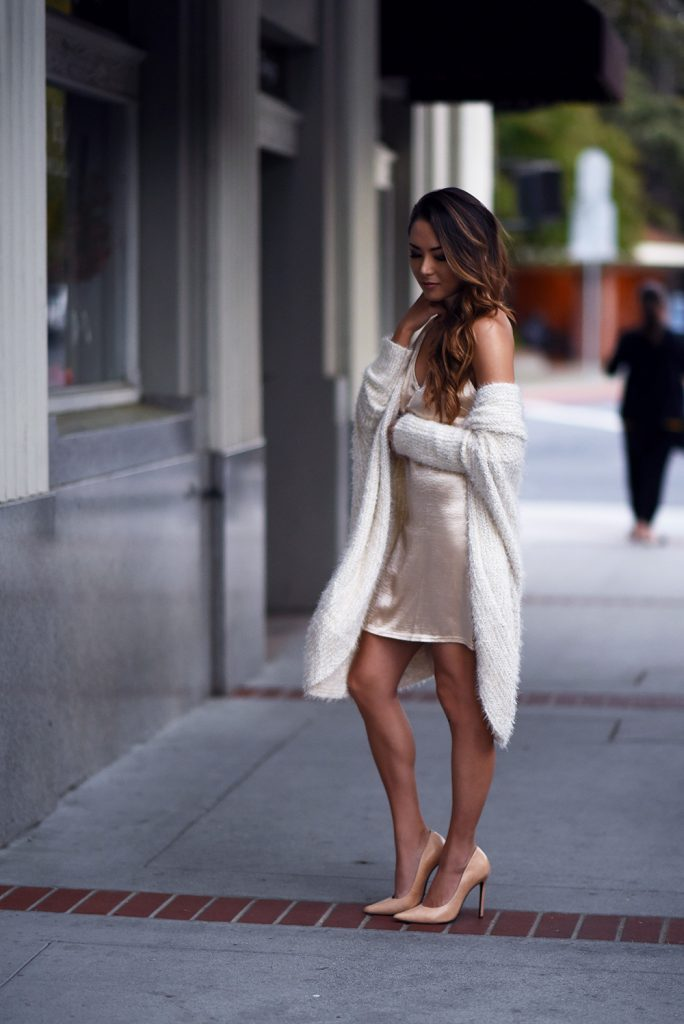 Jessica R. is an absolute vision in this understated slip dress, in a beautiful shade of rose gold. Pairing this dress with knitwear and heels, Jessica has totally captured the essence of the pyjama trend.   Dress: Amazon,  Cardigan: Tennorth, Heels: Schutz.