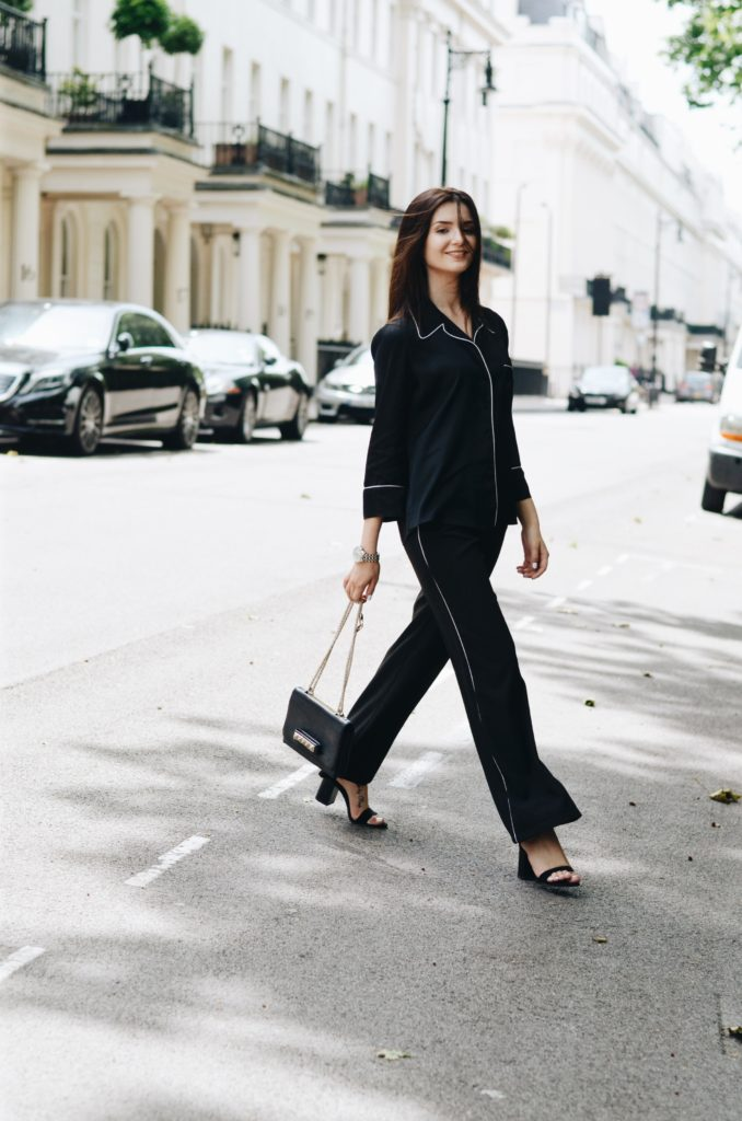 Lolita Masagutova stays elegant by styling her pyjamas inspired co-ord with strappy heels and a statement bag. We love the boyfriend watch too, which adds a touch of daintiness to the whole look.  Shirt: Zara Studio, Pants: Dorothy Perkins,  Heels: Zara, Watch: Thomas Sabo, Bag: Valentino