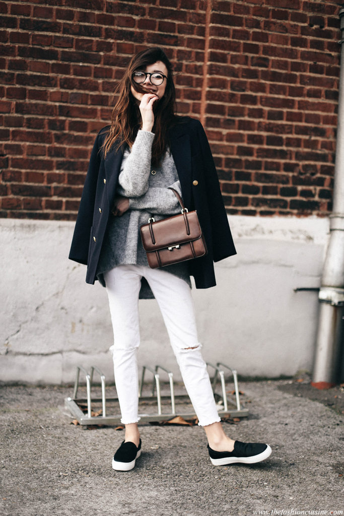 Beatrice Gutu opts for an understated look that heroes this military jacket. She wears it over a lightweight sweater and jeans, and accessorizes the look with black slip-ons and a vintage bag.  Military blazer: Marks & Spencer, knit: Les Petites,  Jeans: LTB, Shoes: Mango, Bag: Vintage