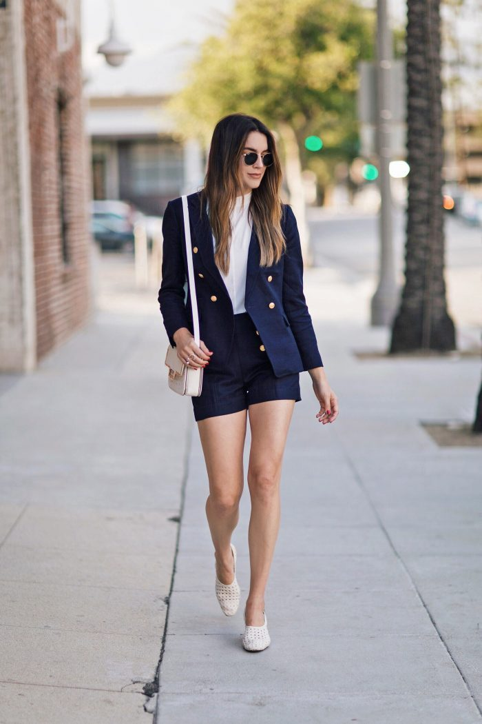 Brittany Xavier has combined the elements of this nautical-themed ensemble in a youthful and refreshing away. The military jacket, elegant white top and tailored short add a preppy feel to this outfit. Blazer and shorts: Banana Republic, Shoes and bag: Zara Sunglasses: Ray-Ban