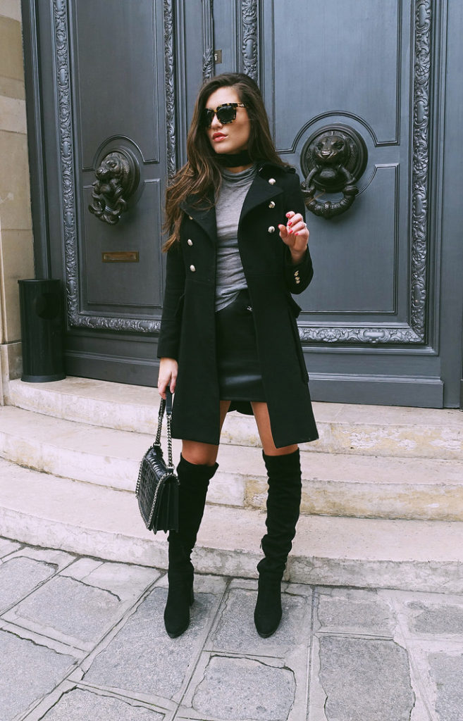 Ilirida's ensemble brings together the military coat, re-emerging mini and over-the knee boots. Accents of silver in the buttons and the bag chain add an elegance to the overall look.  Jacket: Zara, Boots: Missguided, Skirt and shirt: H&M, Bag: Zara, Watch: Arne Jacobsen