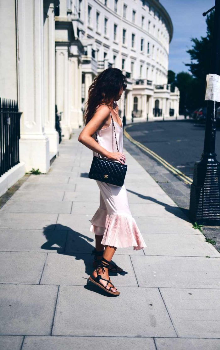 Lorna Luxe opts for a silk pink slip dress and matches it with some sandals and a show stopping Chanel handbag. Dress: Unbalance, Sandals: Heewan, Sandals: Isabel Marant, Bag: Chanel