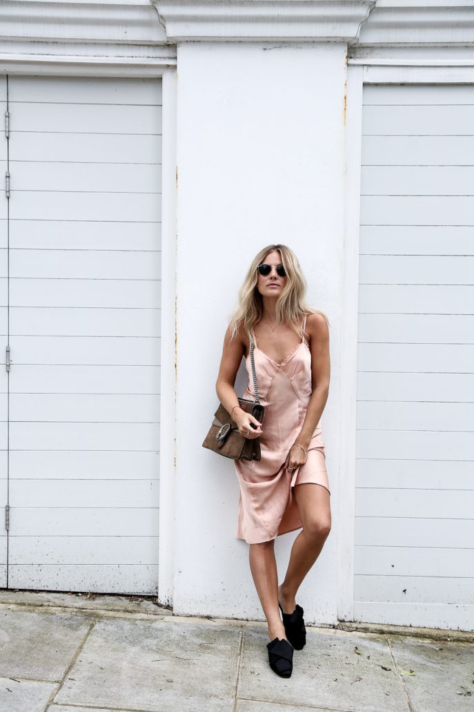 Another beach look, Lucy Williams knows exactly how to style the slip dress with these gorgeous slip on shoes. Blush Silk Slip: Ghost, Black Satin Slides: H&M, Bag: Gucci, Navy silk slip: Asceno, Horn Necklace: Lucy Williams, X Missoma Pearl and silver ring: Cornelia Webb