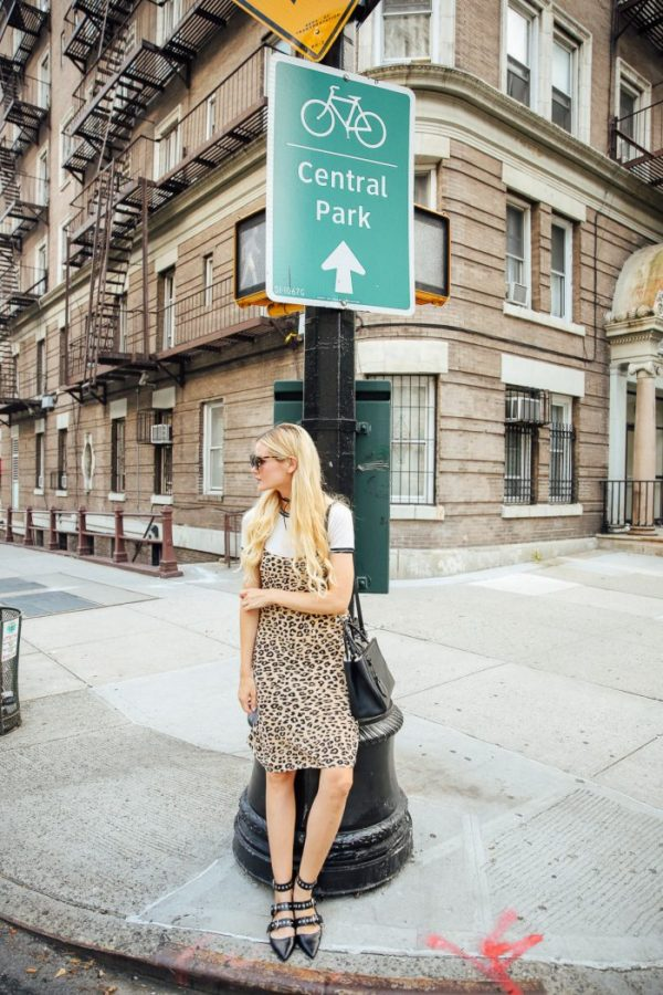 Amber Fillerup Clark is looking cute and casual in this leopard print slip dress, worn over a plain white tee and strappy heels. We love this look for everyday wear or going out attire! Dress: Equipment, Shirt: Rag & Bone, Flats: Zara, Bag: Saint Laurent.