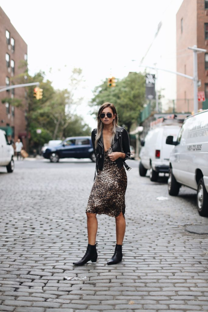 Break the mould this season and dare to wear an animal printed slip dress like Danielle Bernstein. This leopard print piece has a plunging neckline, and paired with a leather jacket is the perfect blend of sexy sleekness.   Dress: Nili Lotan, Jacket: R13, Boots: Archive.