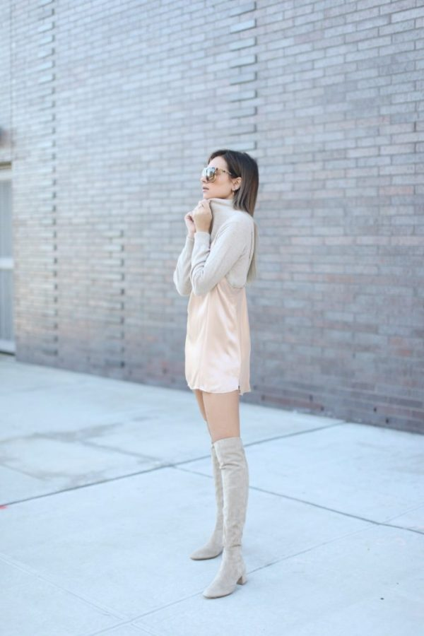 Danielle Bernstein is sleek and glammy in this cute fall outfit, consisting of a knitted sweater worn with a slip dress over the top. This style is achievable and chic, creating a really stunning look when worn with knee high boots. Dress: Are You Am I Slip, Sweater: Reformation, Boots: Gianvitto Rossi.