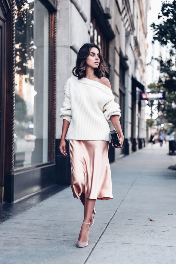 Annabelle Fleur is wearing a gorgeous silk slip dress, paired with an off the shoulder knitted sweater for a sophisticated yet cosy winter look. Pair this style with minimal jewellery and heels for a stripped back, feminine look. Brands not specified.