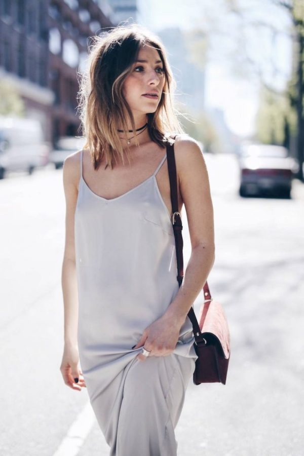 Jill Lansky is dreamy in a muted slip dress and earth-toned accessories. Her casual hairstyle and smoky eye look sensual with a layered black choker and subtle pearl pendant. Dress and Choker: Express, Bag: A.P.C.