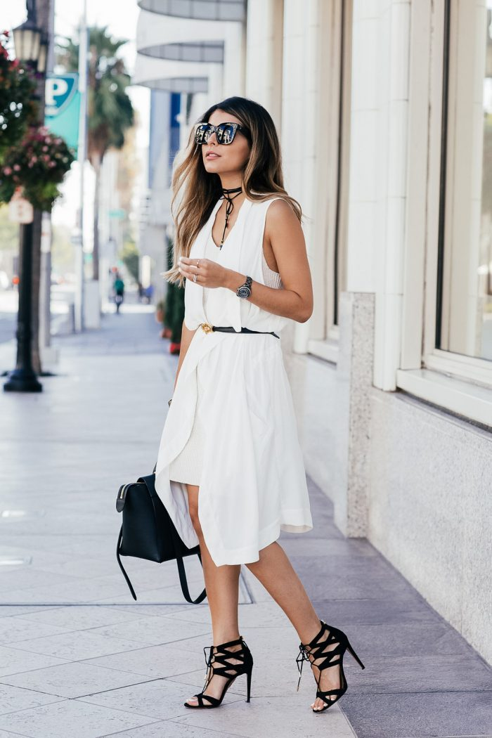 Expertly styled in a wrapped choker, Pam Hetlinger is chic in black, white and straps all over. Even her white toenail polish matches! Dress and Vest: BB Dakota, Shoes: Aquazzura, Bag, Sunglasses and Belt: Céline, Choker: Nordstrom