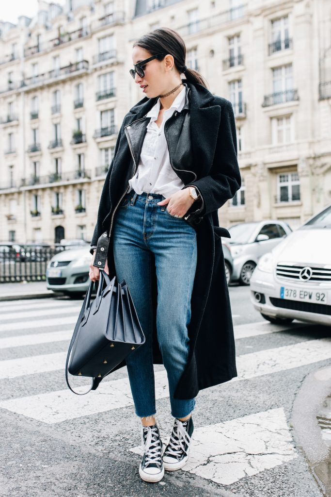 Alexandra Guerain is channelling punk rock royalty with this incredibly cool trench coat, high-wasted denim, Converse, and what else? A classic black tattoo choker.    Bag: Saint Laurent, Shoes: Converse, Jeans: Levi's, Shirt and Jacket: ASOS