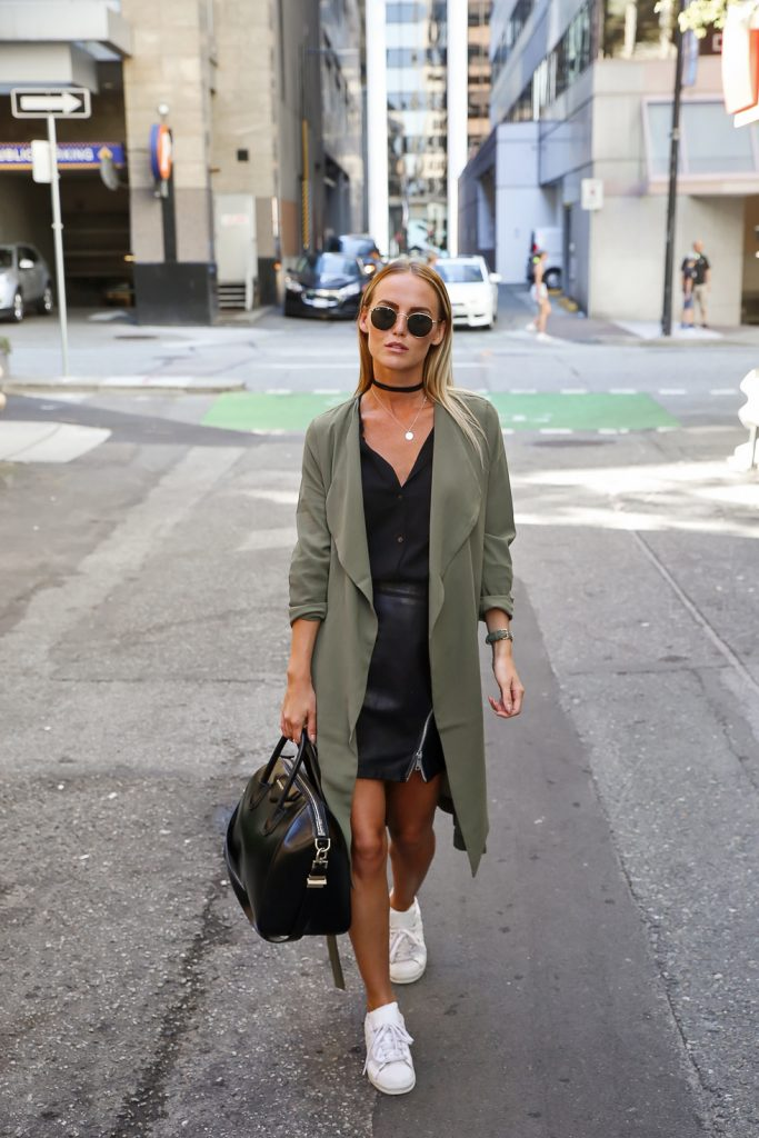 Olive green brings military chic to streetwear, polished off by a matching watch and crisp white sneakers. A simple black choker is paired with a delicate silver chain, complemented by the open neck of this soft black blouse. Via Kristin Sundberg  Jacket and Shirt: Cubus, Bag: Givenchy, Sunglasses: Rayban