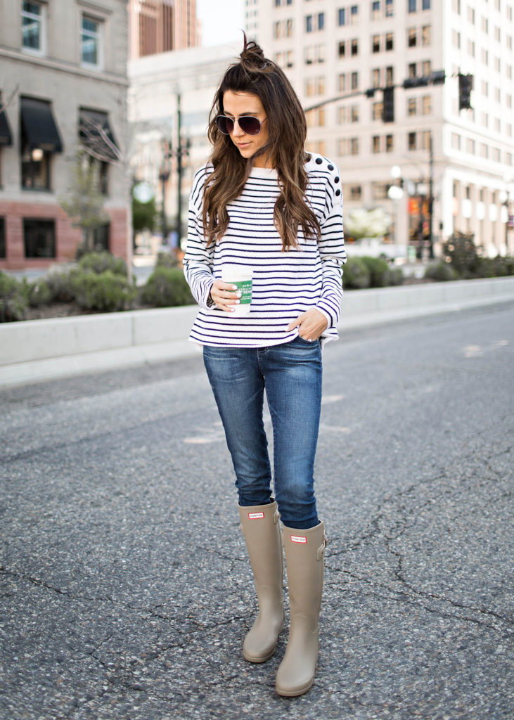 Christine Andrew teams her skinny blue jeans with these matte khaki Hunter Boots for a classic update to the striped tee Breton look. The aviator style sunnies and on-trend hair style finish the look perfectly.  Striped tee: ATM Anthony Thomas Melillo, Jeans: AG, Sunglasses, Prada, Boots: Hunter